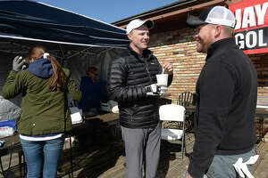 West Brook alumni and MLB player Jay Bruce talks with golf tournament participant Travis Ewest while on a lunch break from play at the Jay Bruce Golf Benefit Saturday at Bayou Din Golf Club in Beaumont. The annual event benefits children and adults with intellectual and developmental disabilities. Photo taken Saturday, January 13, 2018 Kim Brent/The Enterprise
