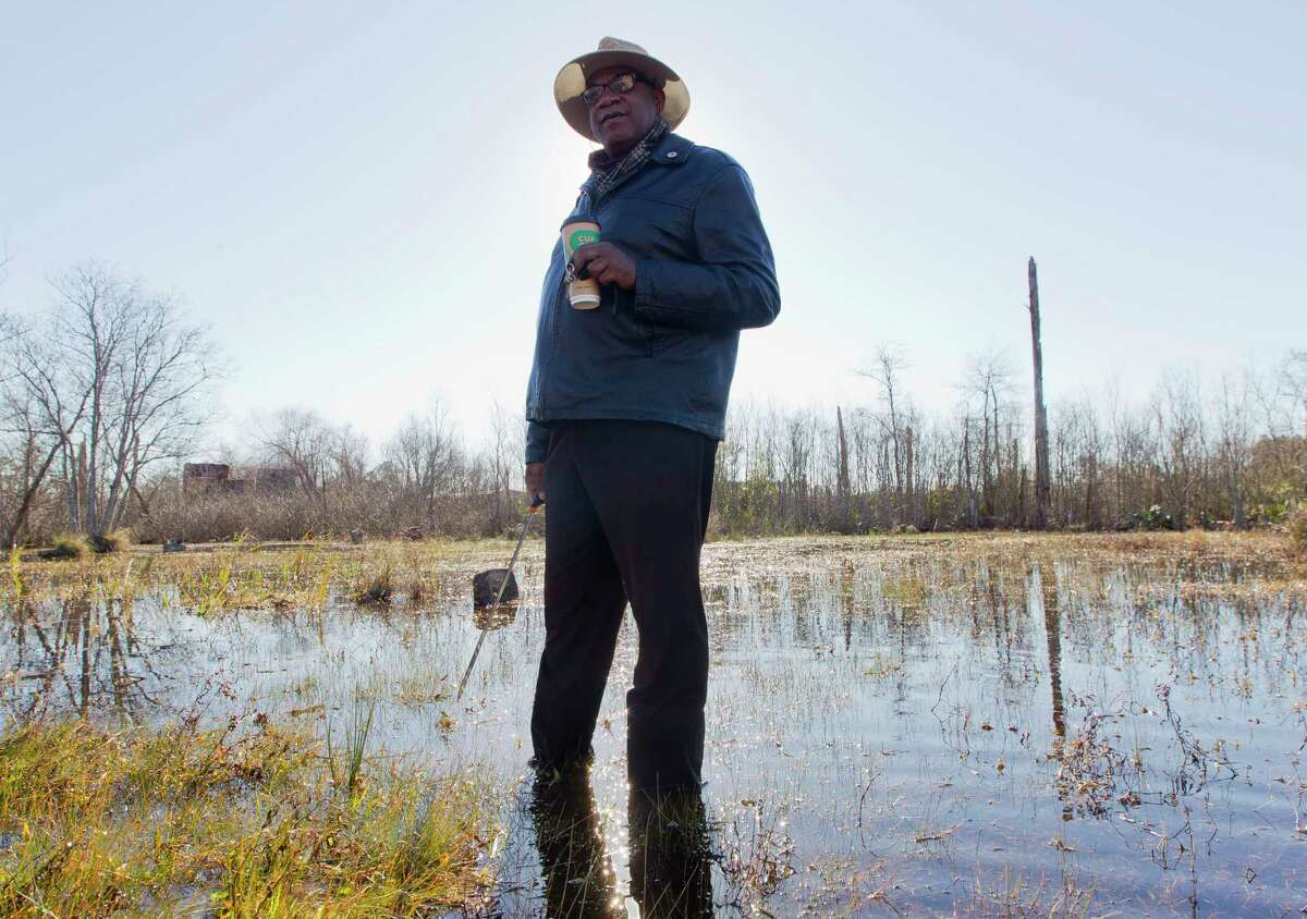 Elikah Easley, chairman of the Tamina Cemetery Project Community Development Corporation, walks through the flooded Sweetrest Cemetery, Saturday, Jan. 13, 2018, in the historic Tamina community. The 12-acer cemetery is the resting place for approximately 261 members of the founding Montgomery County community founded by freed slaves near The Woodlands.