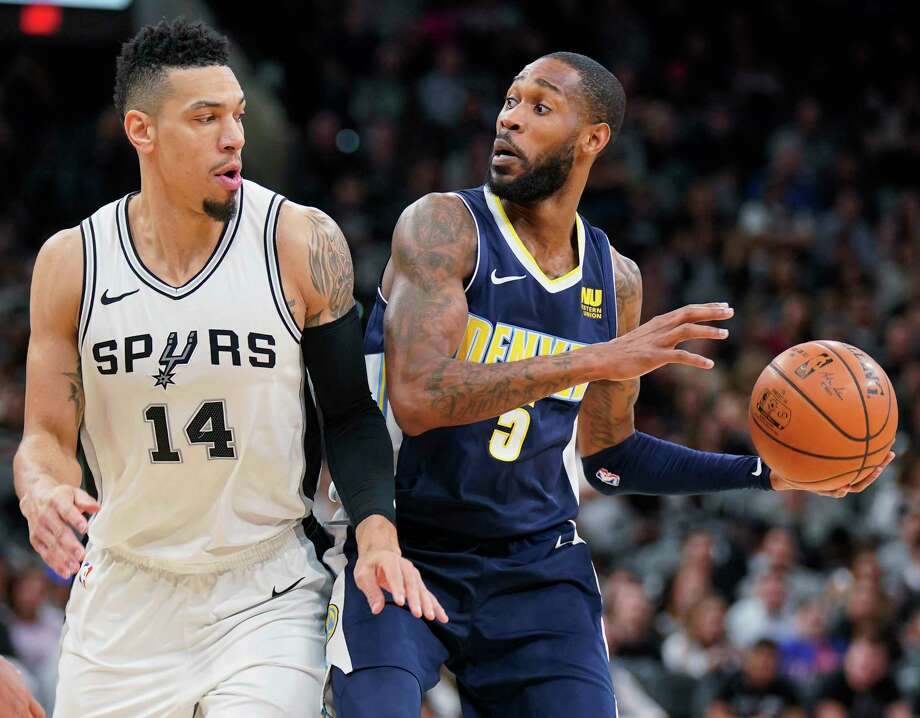 Denver Nuggets' Will Barton (5) drives against San Antonio Spurs' Danny Green during the first half of an NBA basketball game Tuesday, Jan. 30, 2018, in San Antonio. (AP Photo/Darren Abate) Photo: Darren Abate, Associated Press / FR115 AP