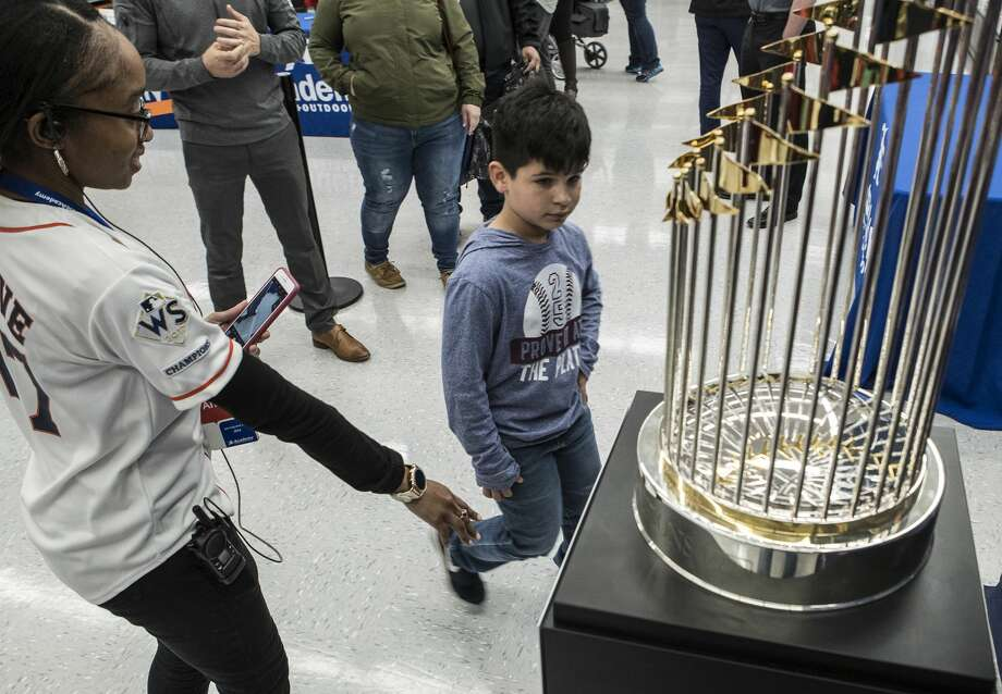 Diego Cordero walks to have his picture taken with the Commissioner's Trophy as part of the Astros World Series trophy tour on Friday, Jan. 12, 2018, in Katy. ( Brett Coomer / Houston Chronicle ) Photo: Brett Coomer/Houston Chronicle