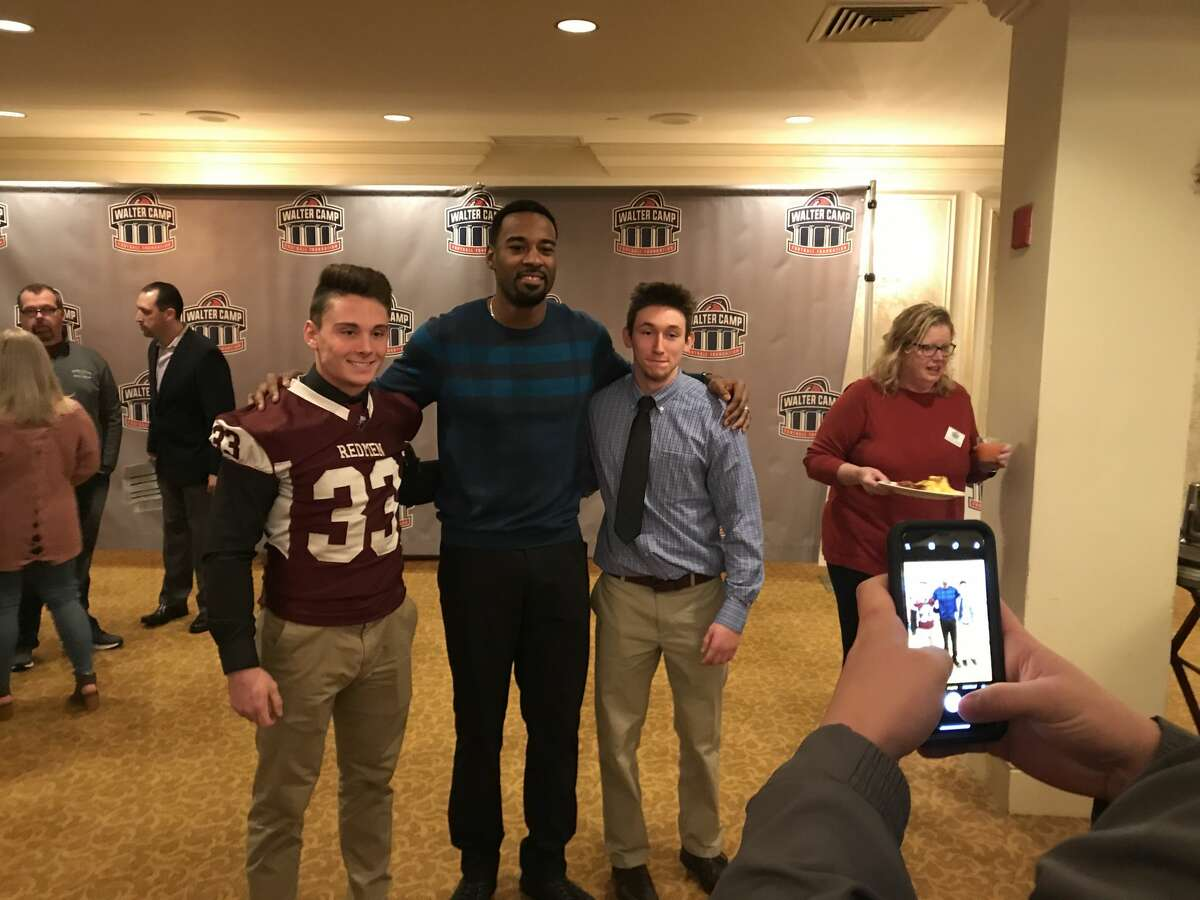 Killingly's Spencer Lockwood (left) poses with former Georgia Tech/Indianapolis Colts star Calvin Johnson at the 11th Annual Walter Camp Breakfast of Champions Saturday, January 13, 2018.