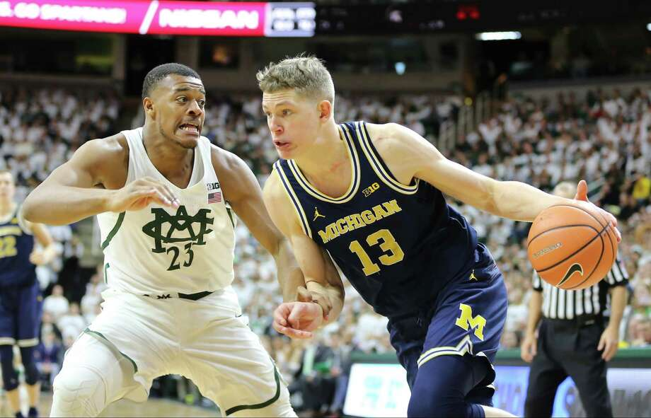 Michigan's Moritz Wagner, right, was rarely stopped by Xavier Tilman and his Michigan State teammates Saturday, scoring a career-high 27 points in the Wolverines' 82-72 victory at East Lansing, Mich. Photo: Rey Del Rio, Stringer / 2018 Getty Images