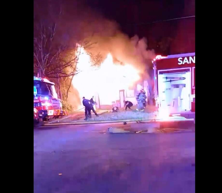 Dramatic footage shows San Antonio firefighters risking their lives to fight a fire and barely escaping from a home engulfed in flames on the East Side Saturday night, Jan. 13, 2018. Photo: Courtesy