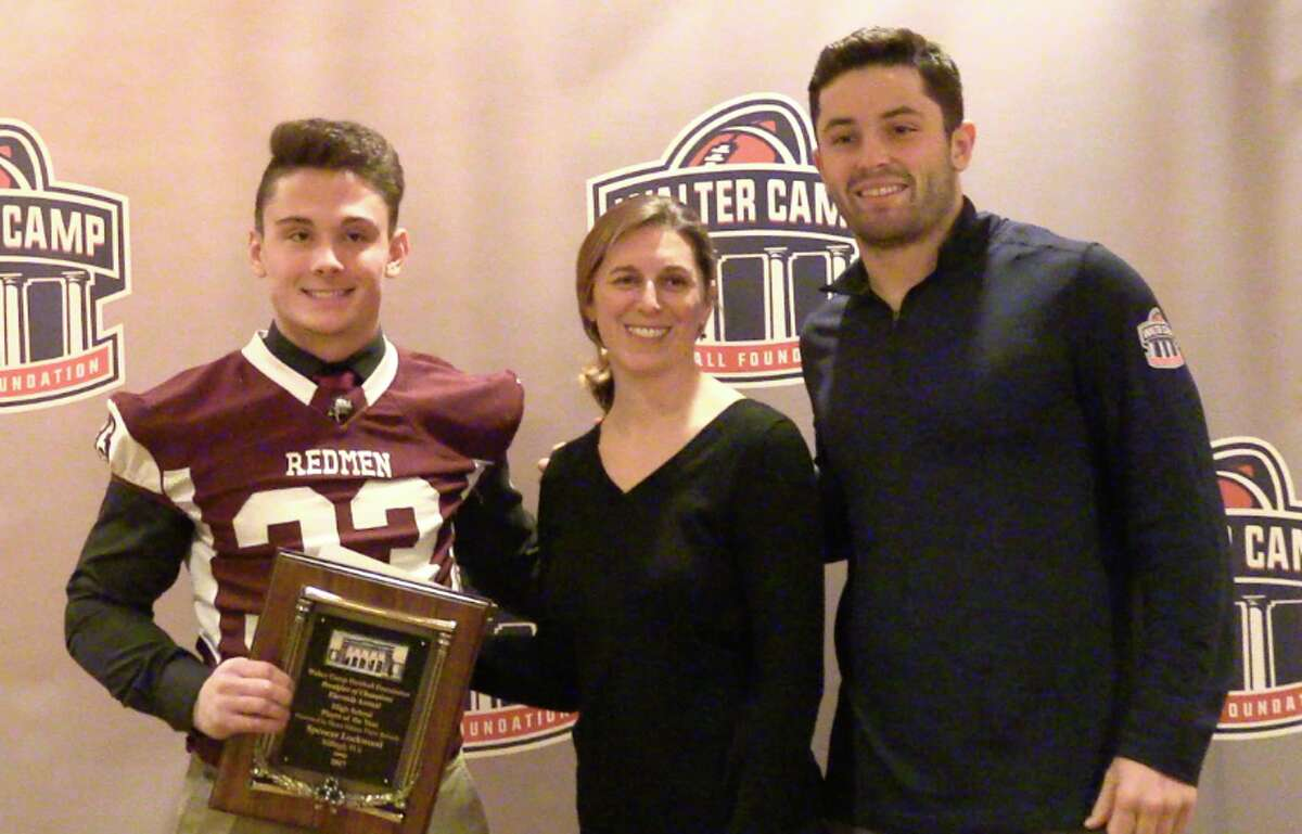 Killingly's Spencer Lockwood (left) poses with Baker Mayfield (right) after winning the Walter Camp Football Foundations Connecticut Player of the Year Award
