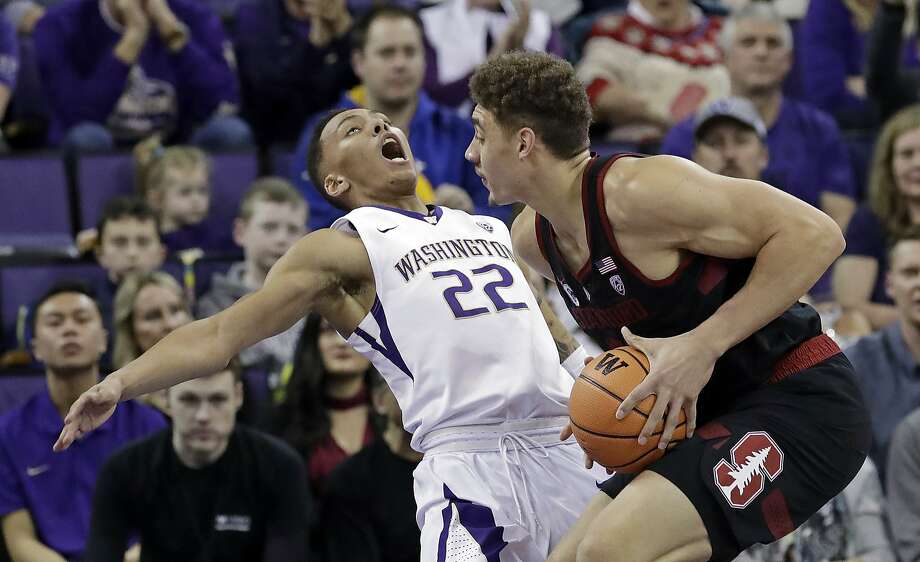 Washington's Dominic Green (22) tumbles backward after colliding with Stanford's Reid Travis in the first half of an NCAA college basketball game Saturday, Jan. 13, 2018, in Seattle. (AP Photo/Elaine Thompson) Photo: Elaine Thompson, Associated Press