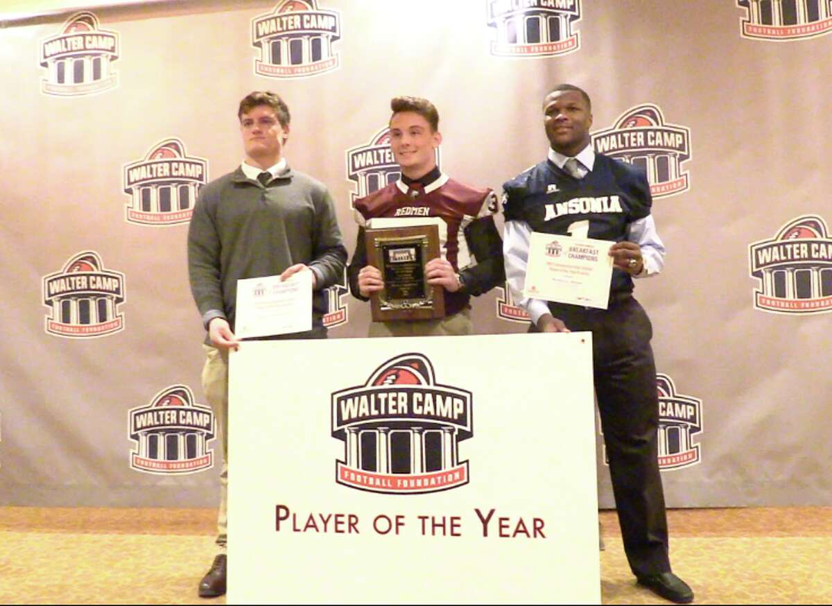 Killingly's Spencer Lockwood (center) poses with his Walter Camp Connecticut Player of the Year award alongside finalists Brian Casagrande of Hand (left) and Markell Dobbs of Ansonia (right) during the Walter Camp Breakfast of Champions, Saturday, January 13, 2018 at the Omni Hotel in New Haven.