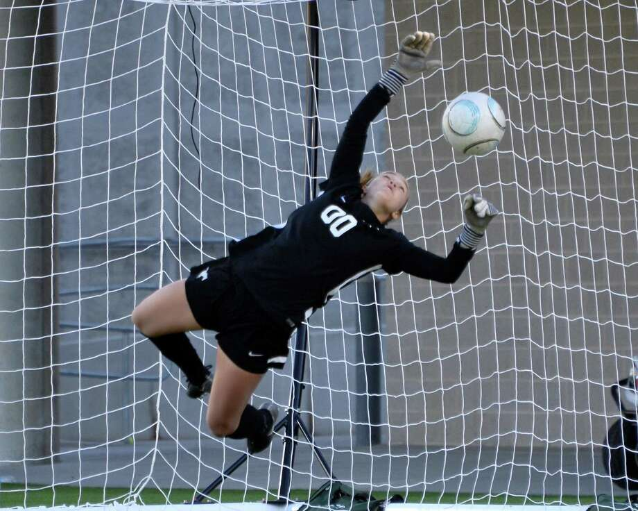 Memorial goalkeeper Bella Kilgore (00) blocks a penalty kick to help the Mustangs win the Falcon Bracket championship game of the I-10 Shootout between the Tompkins Falcons and the Memorial Mustangs on Saturday January 13, 2018 at Legacy Stadium, Katy, TX. Photo: Craig Moseley, Staff / ©2016 Houston Chronicle