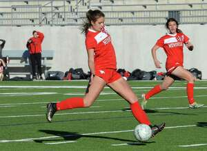 Mary Grace Sullivan (25) of Memorial kicks a goal during the second half of the Falcon Bracket championship game of the I-10 Shootout between the Tompkins Falcons and the Memorial Mustangs on Saturday January 13, 2018 at Legacy Stadium, Katy, TX.
