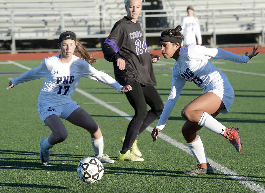 Port Neches - Groves' Kelsie Comeaux (left) moves in to assist as Ariel Muller moves the ball down field against College Station during their match-up of the soccer tournament held at PNG Friday. Photo taken Friday, January 12, 2018 Kim Brent/The Enterprise Photo: Kim Brent / BEN