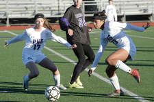 Port Neches - Groves' Kelsie Comeaux (left) moves in to assist as Ariel Muller moves the ball down field against College Station during their match-up of the soccer tournament held at PNG Friday. Photo taken Friday, January 12, 2018 Kim Brent/The Enterprise
