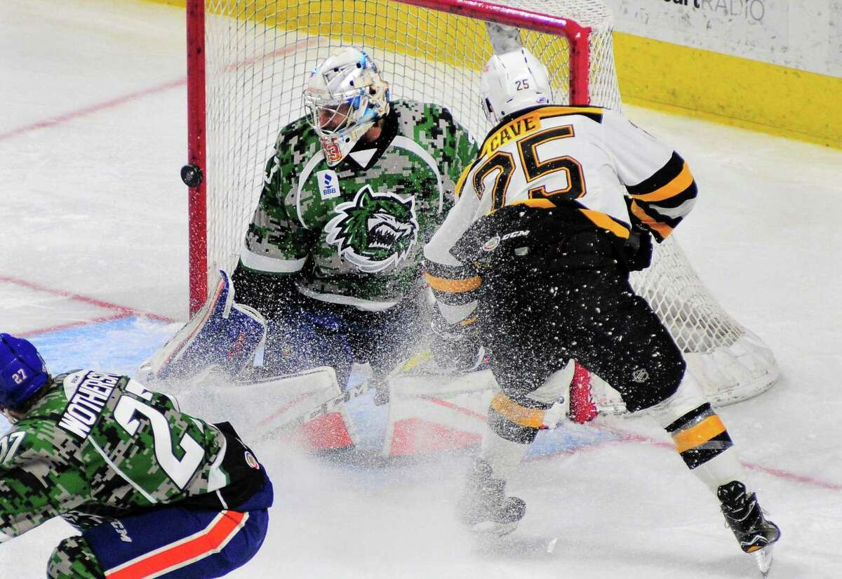 Sound Tigers goalie Christopher Gibson defledts a shot by Providence's Colby Cave during AHL hockey action at the Webster Bank Arena in Bridgeport, Conn. on Saturday Jan. 12, 2018.