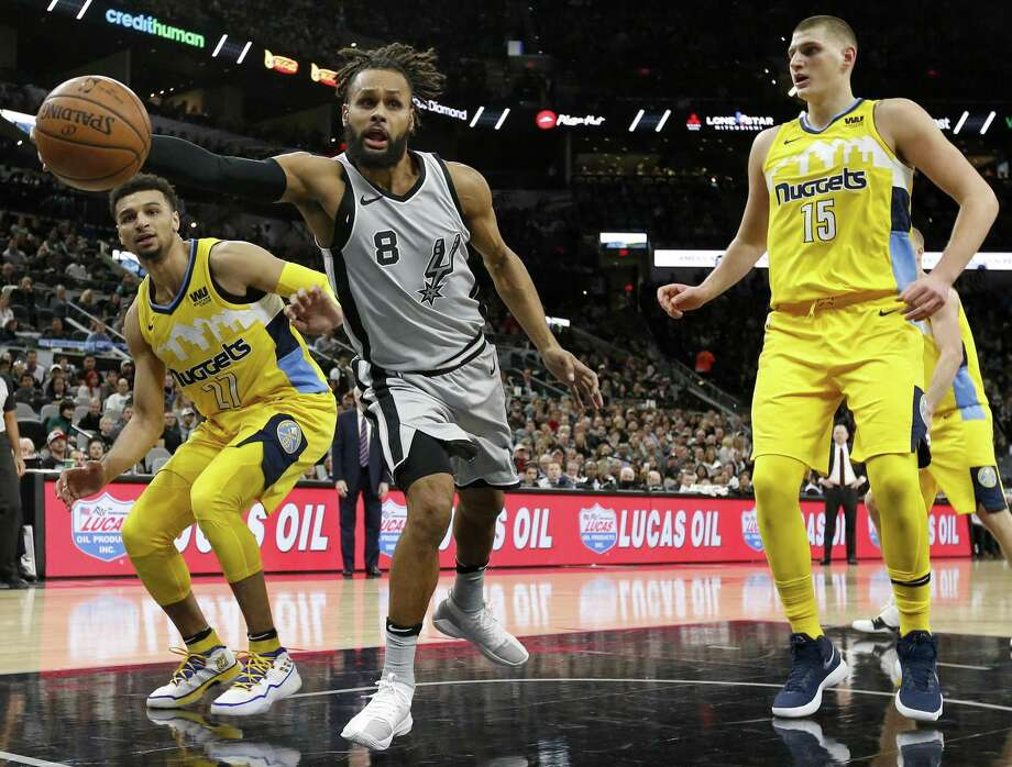 San Antonio Spurs' Patty Mills grabs for a loose ball between Denver NuggetsÕ Jamal Murray (left) and Nikola Jokic during first half action Saturday Jan. 13, 2018 at the AT&T Center. Photo: Edward A. Ornelas, Staff / San Antonio Express-News / © 2018 San Antonio Express-News