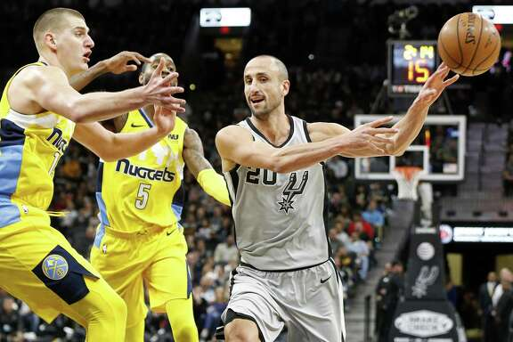 San Antonio Spurs' Manu Ginobili passes around Denver NuggetsÕ Nikola Jokic (left) and Will Barton during first half action Saturday Jan. 13, 2018 at the AT&T Center.
