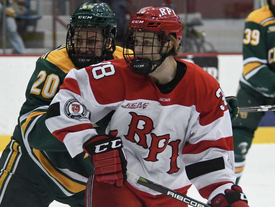 Clarkson University defenseman Jere Astren pushes into Rensselaer Polytechnical Institute forward Emil …hrvall during a game on Saturday, Jan. 13, 2017, on RPI campus in Troy N.Y. (Jenn March/Special to the Times Union) Photo: Jenn March / © Jenn March 2017-18 © Albany Times Union 2017-18