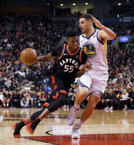 Raptors guard Delon Wright, left, drives against Warriors guard Klay Thompson.  Toronto lost for just the third time in 18 home games this season. Photo: Cole Burston, SUB / CP