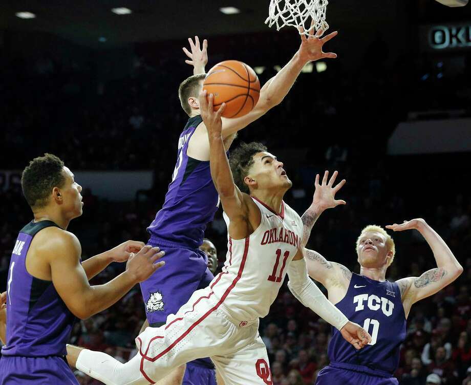 Surrounded by TCU defenders, Oklahoma's Trae Young nonetheless makes a concerted effort to score two of his 43 points Saturday. Photo: Garett Fisbeck, FRE / AP2018