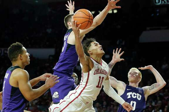 Surrounded by TCU defenders, Oklahoma's Trae Young nonetheless makes a concerted effort to score two of his 43 points Saturday.