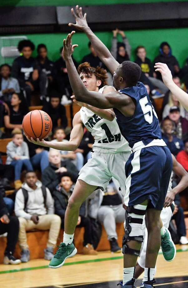 Green Tech'sJoshua Rodriguez (1) moves the ball past Mekeel Christian Academy's  Gideon Agbo (55) during the first half of a high school basketball game on Saturday, Jan.13, 2018, in Albany, N.Y. (Hans Pennink / Special to the Times Union) Photo: Hans Pennink / 20042651A