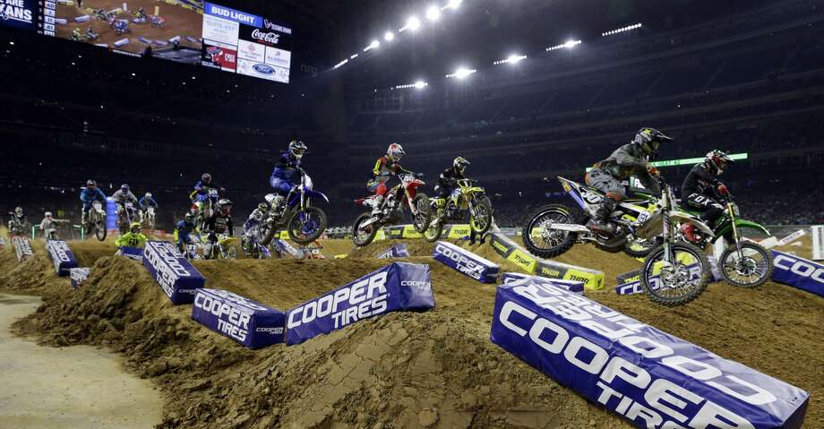 Riders on the first straight away of the second heat of the 250SX during the Monster Energy Supercross held at NRG Stadium in Houston, TX, Jan. 13, 2018. (Michael Wyke / For the  Chronicle) Photo: Michael Wyke/For The Chronicle