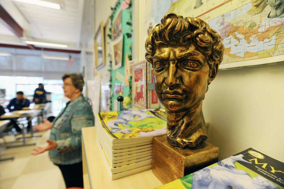 The bust of a Roman Emperor sits at the front of Ana Koltypin's classroom as she leads a Latin class at AITE High School in Stamford, Conn., on Dec. 8, 2016. Enrollment in Latin courses within Stamford Public Schools has steadily decreased in recent years, but there is still a lot of interest from students. (Michael Cummo / Hearst Connecticut Media) Photo: Michael Cummo, Staff Photographer / Stamford Advocate