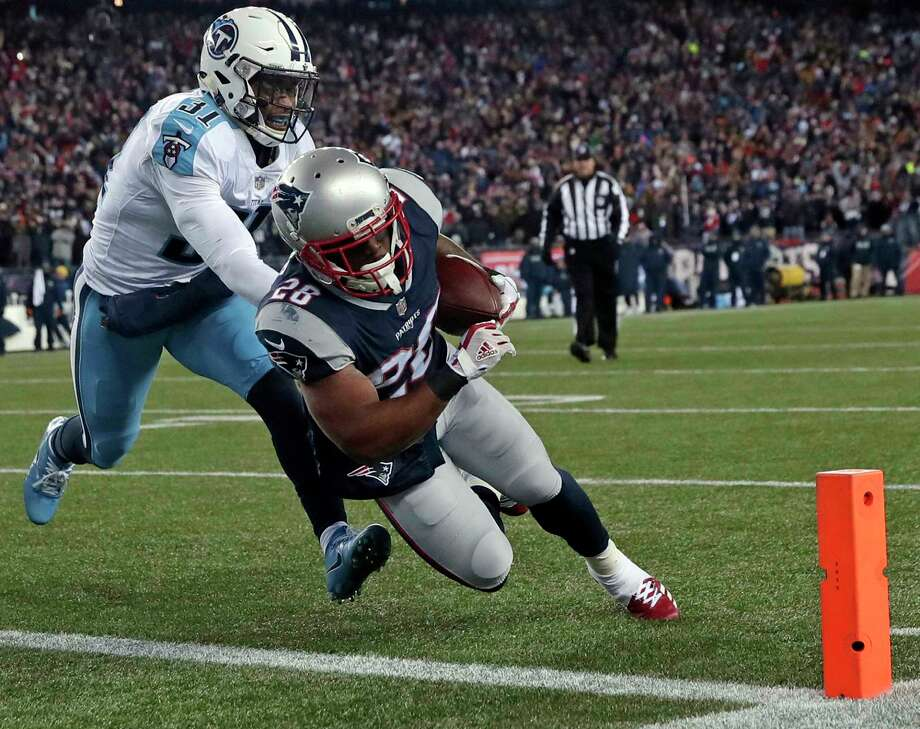 New England Patriots running back James White, right, runs past Tennessee Titans safety Kevin Byard (31) for a touchdown during the first half of an NFL divisional playoff football game, Saturday, Jan. 13, 2018, in Foxborough, Mass. (AP Photo/Charles Krupa) Photo: Charles Krupa, STF / Copyright 2018 The Associated Press. All rights reserved.