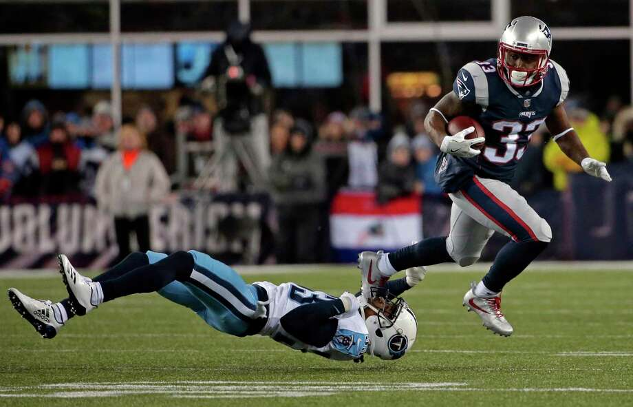 New England Patriots running back Dion Lewis, right, eludes Tennessee Titans cornerback Tye Smith during the first half of an NFL divisional playoff football game, Saturday, Jan. 13, 2018, in Foxborough, Mass. (AP Photo/Steven Senne) Photo: Steven Senne / Copyright 2018 The Associated Press. All rights reserved.
