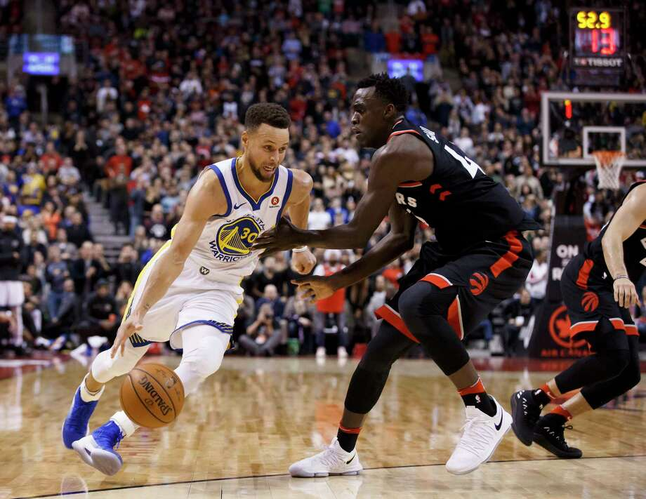 Golden State Warriors guard Stephen Curry (30) drives to the basket against Toronto Raptors forward Pascal Siakam (43) during the second half of an NBA basketball game Saturday, Jan. 13, 2018, in Toronto. (Cole Burston/The Canadian Press via AP) Photo: Cole Burston / CP