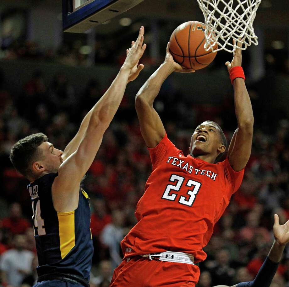 Texas Tech's Jarrett Culver (23) shoots the ball around West Virginia's Chase Harler (14) during the second half of an NCAA college basketball game Saturday, Jan. 13, 2018, in Lubbock, Texas. (AP Photo/Brad Tollefson) Photo: Brad Tollefson / FR171432 AP