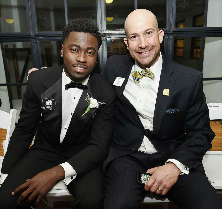Ervin Philips, former West Haven standout and wide receiver at Syracuse University, the Connecticut Player of the Year and Al Carbone at the Walter Camp Football Foundation 51st annual awards dinner, Saturday, Jan. 13, 2018, at the William K. Lanman Jr. Center at Yale University. Photo: Catherine Avalone, Hearst Connecticut Media / New Haven Register