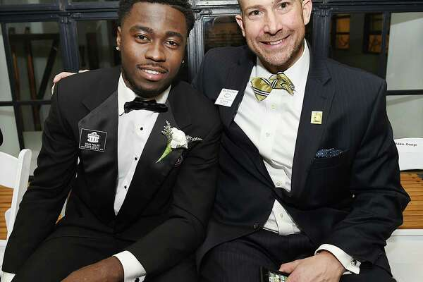 Ervin Philips, former West Haven standout and wide receiver at Syracuse University, the Connecticut Player of the Year and Al Carbone at the Walter Camp Football Foundation 51st annual awards dinner, Saturday, Jan. 13, 2018, at the William K. Lanman Jr. Center at Yale University.