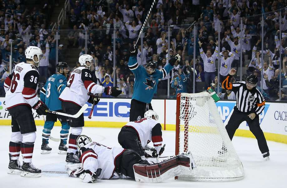 Marc-Edouard Vlasic of the Sharks raises his stick in victory as San Jose beat Arizona in overtime. Photo: Ezra Shaw, Getty Images