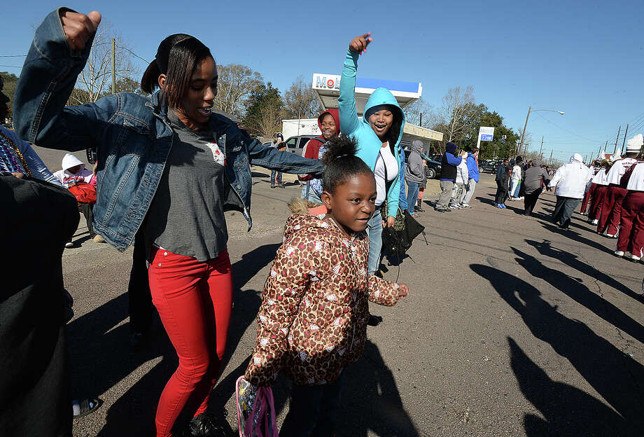 From left, Denise Citizen, Jakyra Citizen, and Marchelle Washington dance as Central High School's marching band performs during the annual MLK parade through South Park Saturday. Photo taken Saturday, January 13, 2018 Kim Brent/The Enterprise Photo: Kim Brent / BEN