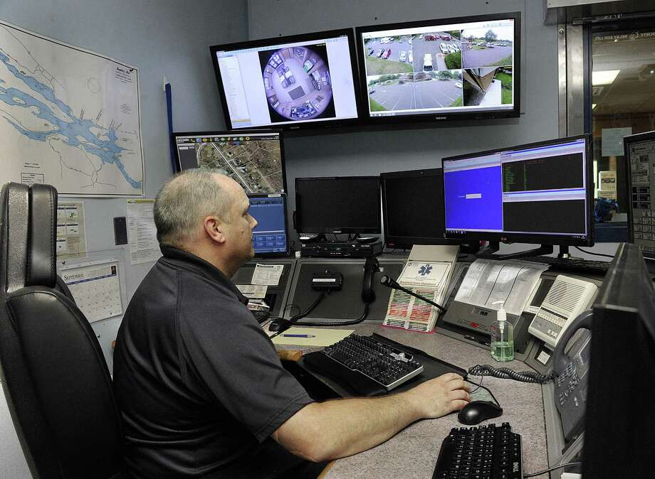 Jim Mooney, an emergency services dispatcher, handles calls at the Brookfield Police Department Friday, Sept. 15, 2017. Photo: Carol Kaliff / Hearst Connecticut Media / The News-Times