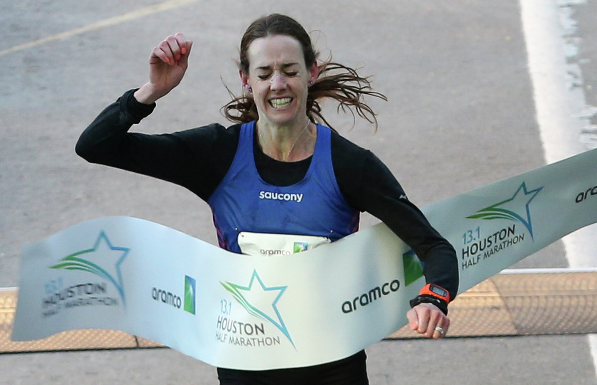 American runner Molly Huddle crosses the Aramco Half Marathon finish line on Sunday, Jan. 14, 2018, in Houston. Huddle broke the U.S. women's half-marathon record with a record in 1:07:26.
