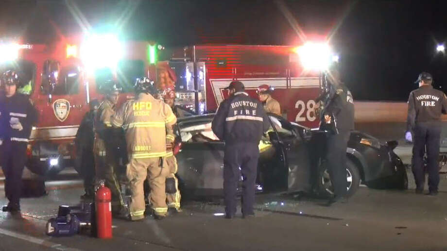 Two people were extricated from a vehicle after an overnight crash on U.S. 59. Photo: Metro Video