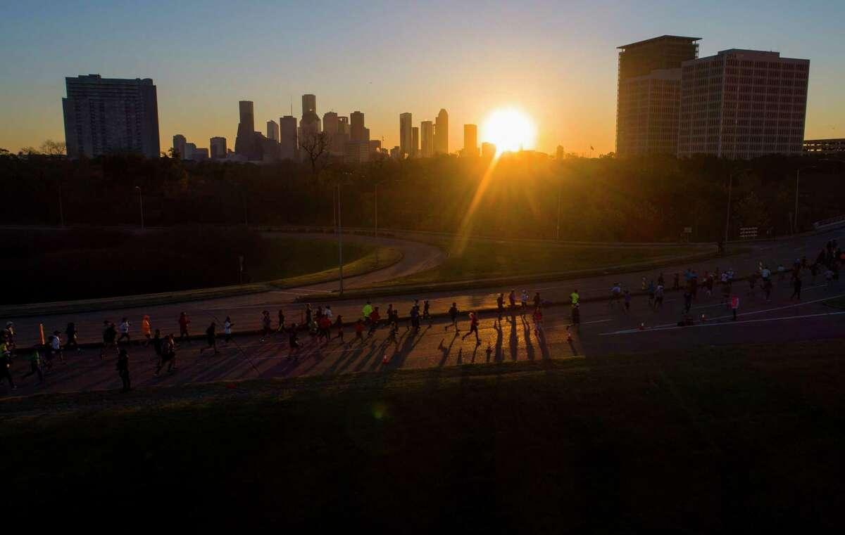 Runners cross Buffalo Bayou on the Waugh Bridge during the Chevron Houston marathon, Sunday, Jan. 14, 2018, in Houston.