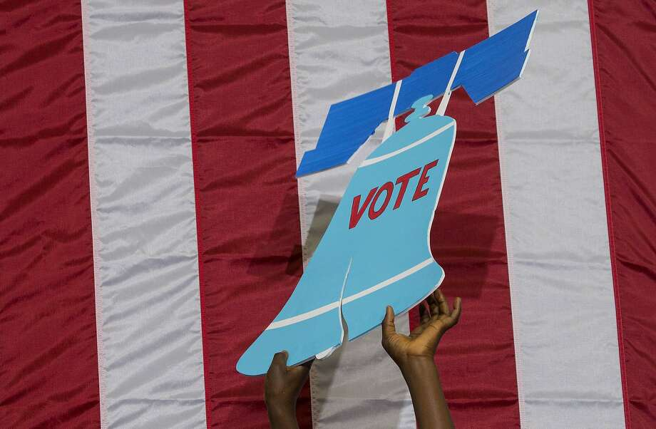 A 'Liberty Bell' sign at a Democratic voter registration drive in Philadelphia, Aug. 16, 2016. The Pennsylvania Supreme Court on Monday struck down the boundaries of the state's 18 congressional districts. Photo: RUTH FREMSON, NYT