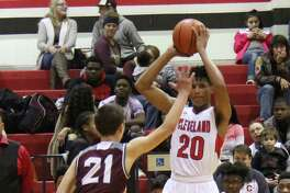 Indian Chance Brown (20) prepares to make a pass to get the ball over Longhorn Blake Ellington (21).