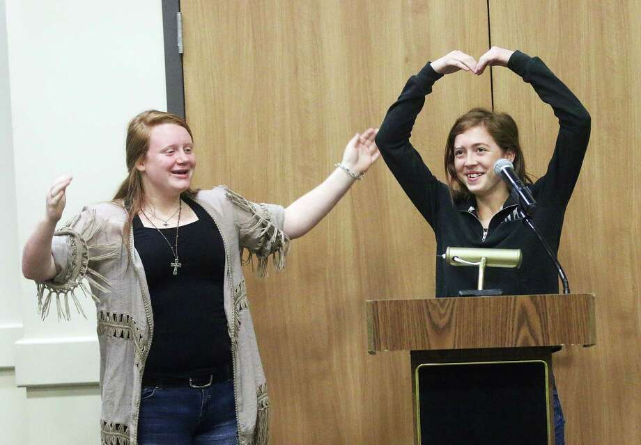 "Kaylie Richardson, left, and Raven Howe demonstrate one of the many camp songs they learned while at the Rotary Youth Leadership Awards. This one was titled ""Milk!"" Photo: David Taylor"