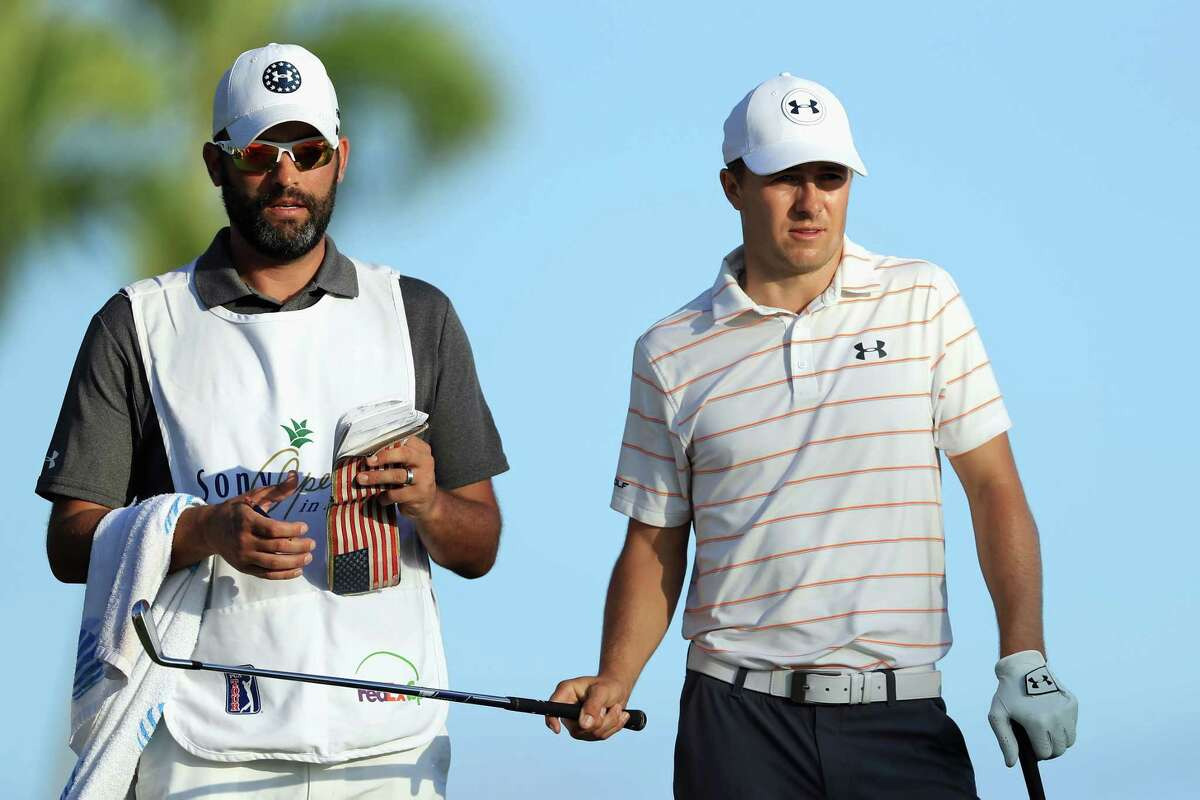 HONOLULU, HI - JANUARY 12: Jordan Spieth of the United States prepares to play his shot from the 17th tee during round two of the Sony Open In Hawaii as caddie Michael Greller looks on at Waialae Country Club on January 12, 2018 in Honolulu, Hawaii.