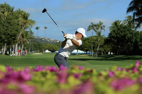 HONOLULU, HI - JANUARY 12:  Jordan Spieth of the United States plays his shot from the tenth tee during round two of the Sony Open In Hawaii at Waialae Country Club on January 12, 2018 in Honolulu, Hawaii.
