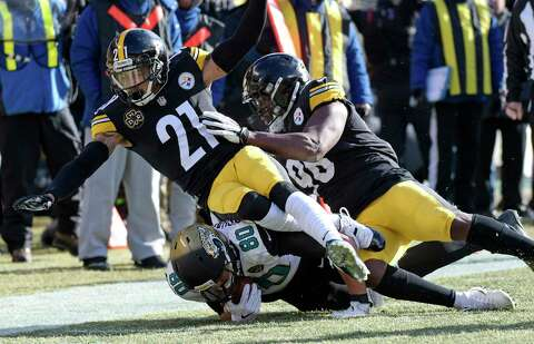 057e1df2bd2 Jacksonville Jaguars tight end James O Shaughnessy (80) is tackled by Pittsburgh  Steelers