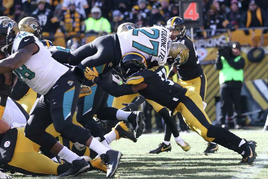 PITTSBURGH, PA - JANUARY 14:  Leonard Fournette #27 of the Jacksonville Jaguars dives into the end zone for a touchdown against the Pittsburgh Steelers during the first half of the AFC Divisional Playoff game at Heinz Field on January 14, 2018 in Pittsburgh, Pennsylvania. Photo: Rob Carr, Getty Images / 2018 Getty Images