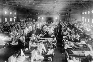Patients being treated at an Army ward in Kansas during the influenza epidemic of 1918. The pandemic of the virus known as Spanish flu in 1918 spread across the globe, infecting about 500 million people and killing roughly 50 million.