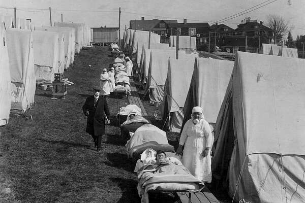 View of tents and patients at an emergency hospital in Brookline, to care for the influenza cases, Massachussetts, October 1918.