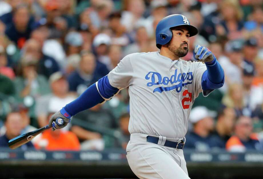 FILE - In this Aug. 18, 2017, file photo, Los Angeles Dodgers' Adrian Gonzalez hits a double against the Detroit Tigers in the second inning of a baseball game in Detroit. Adrian Gonzalez has been released by the Atlanta Braves and is a free agent. Atlanta acquired the 35-year-old as part of Saturday's five-player trade that sent outfielder Matt Kemp to the Los Angeles Dodgers and immediately designated him for assignment and placed him on waivers. Gonzalez waived his no-trade clause after the Braves agreed to cut him from their roster, and he was formally released Monday, Dec. 18, 2017. (AP Photo/Paul Sancya, File) Photo: Paul Sancya, Associated Press / Copyright 2017 The Associated Press. All rights reserved.