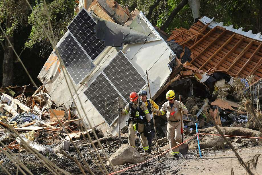 Members of a search and rescue team check a collapsed home in Montecito (Santa Barbara County). The mudslides destroyed at least 65 homes. Photo: JIM WILSON, NYT
