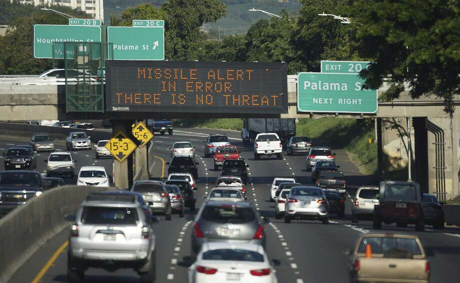 A highway sign in Honolulu advises motorists Saturday that a missile attack warning was mistakenly sent to cell phones. Photo: Anthony Quintano, Associated Press