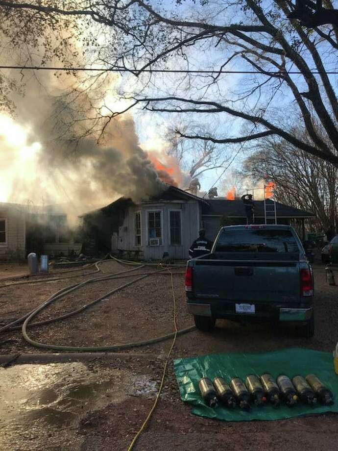At least 11 people lived in home destroyed by a fire on Crooke St. Saturday afternoon in Conroe near Lewis Park, according to Conroe Fire Department officials. Photo: Submitted Photo