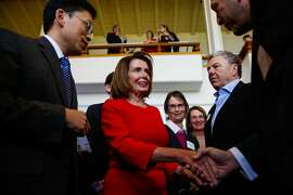 Congresswoman Nancy Pelosi (left) greets supporters at her annual New Years celebration at the Golden Gate Club in San Francisco, California, on Sunday, Jan. 14, 2018.